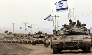 Israeli tanks near the border between Israel and the Gaza Strip in August 2014