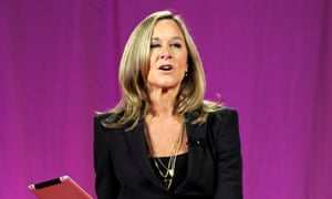 Angela Ahrendts, head of retail for Apple, speaks as she holds an Apple Inc. iPad at the 2011 World Business Forum in New York, U.S., on Wednesday, Oct. 5, 2011.