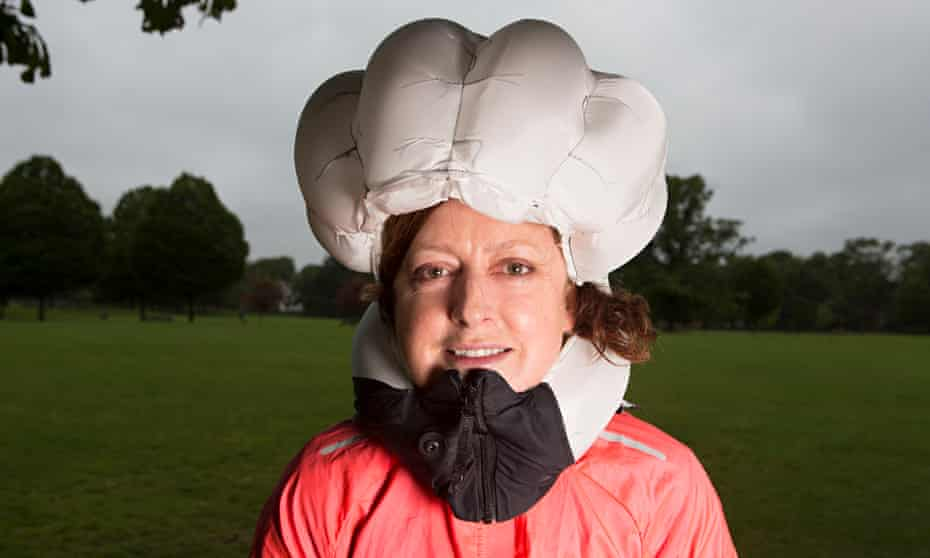 Judith Soal wears the inflated Hovding bike airbag following her simulated crash in north London.