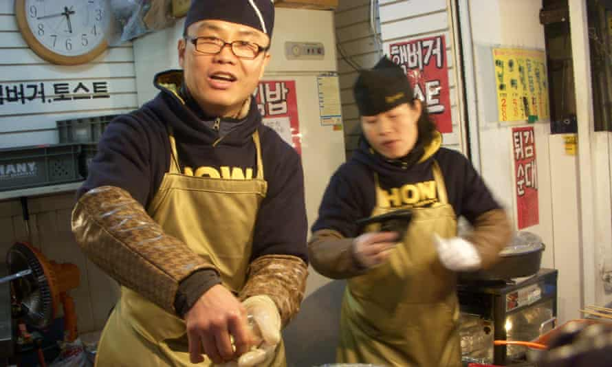 """Hotteok vendors do a great trade in South Korea, but are they as popular in the North? <a href=""""https://www.flickr.com/photos/yearofeats/2347324051/"""">Photograph: /flickr</a>"""