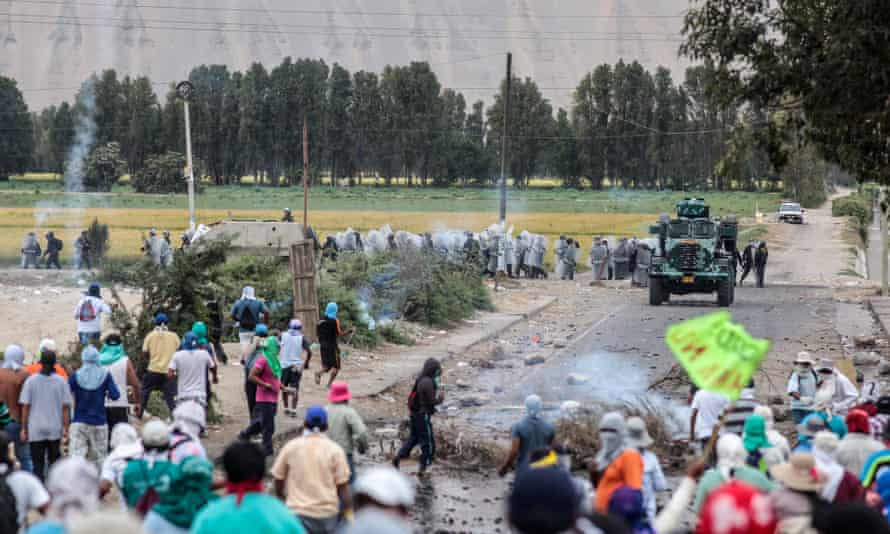 Police fighting local inhabitants in Cocachacra, southern Peru, protesting the proposed Tia Maria mine.