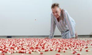 Adrian Searle contemplates the red and white capsules that rain, one every three seconds, from the ceiling.