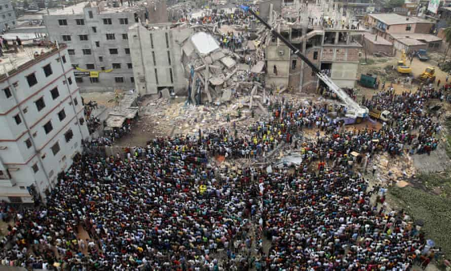 People gather as rescuers look for survivors at the Rana Plaza building in April 2013.