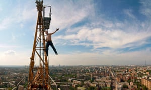The daredevil Muscovite: under an assumed name, urban climber Max Polazov – pictured atop the Garden Ring Hotel – has been scaling his home city's tallest buildings since he was 17.