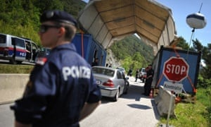 Austrian police officers check cars near the town of Telfs, prior the 2015 Bilderberg conference.