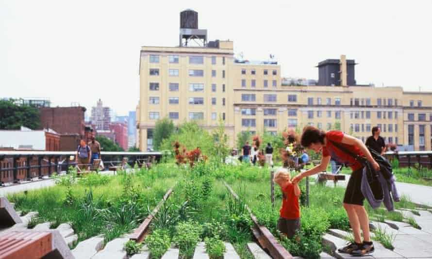 Mother and child explore the Washington Grasslands, Manhattan, NYC