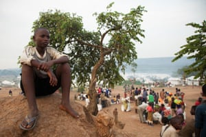 Fifteen-year-old Aimé Sharbert Ruberintwari sits on high ground at the Mahama refugee camp in south-east Rwanda.
