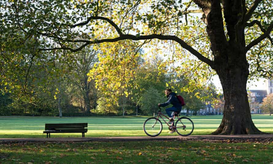 A man cycling in Cambridge