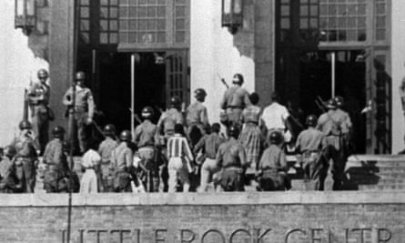 Troops escort nine black students into Central High School in Little Rock, Arkansas on Sept. 25, 1957. A battle over school segregation are the subject of a new book by the journalist Kristen Green. (AP Photo/File)