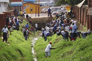 People participate in the monthly clean-up day, Umuganda, in Kigali.