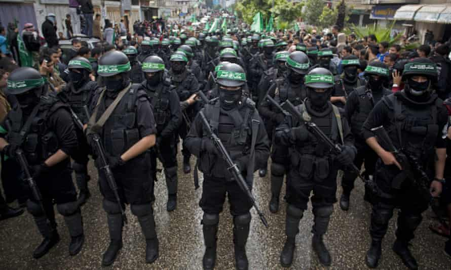 Masked Palestinian gunmen of the Hamas militant group