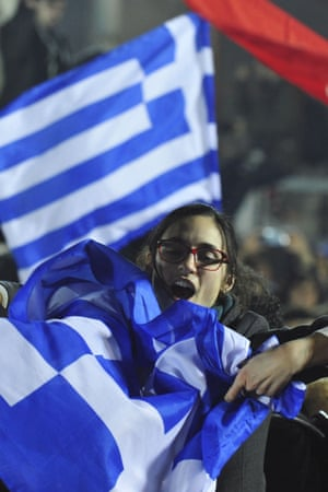 A woman waves a Greek flag.