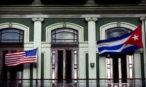 US and Cuban flags flying outside the Hotel Saratoga in Havana.