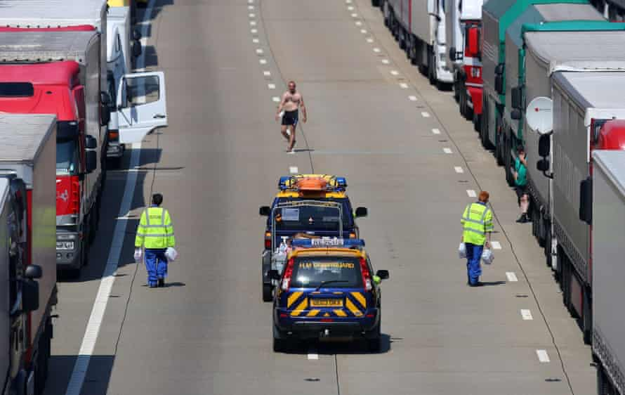 Members of the Coastguard hand out water to stranded lorry drivers on the M20 in Ashford