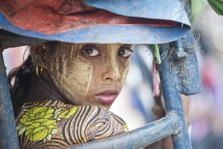 An ethnic Rohingya Muslim woman rides a tuk tuk near a camp set up outside the city of Sittwe in Rakhine state, Burma.