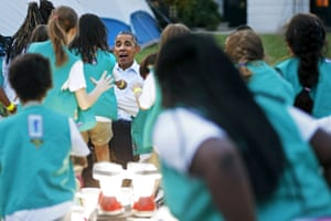 Washington, US President Obama reacts as Girl Scouts rush to him for a group hug as he and first lady Michelle Obama welcome them for a camp-out on the South Lawn of the White House