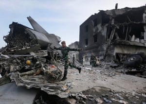 Medan, Indonesia Rescuers search for victims at the crash site of an Indonesian air force transport plane. The Hercules C-130 plane crashed into a residential neighbourhood