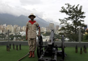 Caracas, Venezuela A soldier prepares to fire a cannon at 4:25 pm, the time the death of Venezuela's late president Hugo Chavez was announced. The cannon is fired daily to commemorate Chavez's death in 2013
