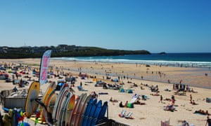 People enjoying the sun at Fistral Beach on June 30, 2015 in Newquay, England.