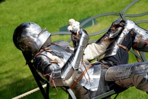 How are you going to eat that? A knight at Warwick Castle attempts eating an ice cream