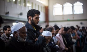 Men attend the first Friday prayers of the Islamic holy month of Ramadan at the East London Mosque on June 19.