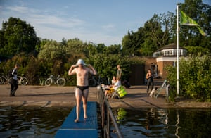 Perfect weather for a dip for the Serpentine Swimming Club in Hyde Park.