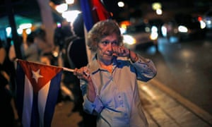 An anti-Castro Cuban exile reacts after the announcement of restoring diplomatic ties between Cuba and United States, at an area knows as 'Little Havana' in downtown Miami, Florida December 17, 2014.