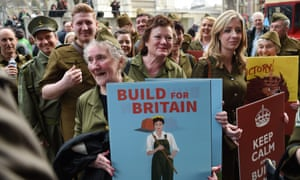 Demonstrators wearing WWII uniforms protest at a Homes for Britain rally in London, calling for political parties to end the crisis within a generation