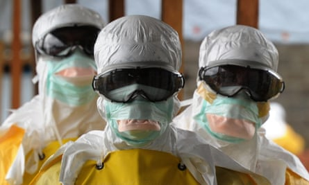 Aid workers in biohazard suits