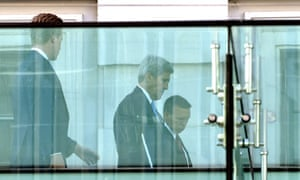 US Secretary of State John Kerry, center, on a balcony at the Palais Coburg where talks between the E3+3 (France, Germany, UK, China, Russia, US) and Iran continue, in Vienna, Austria.