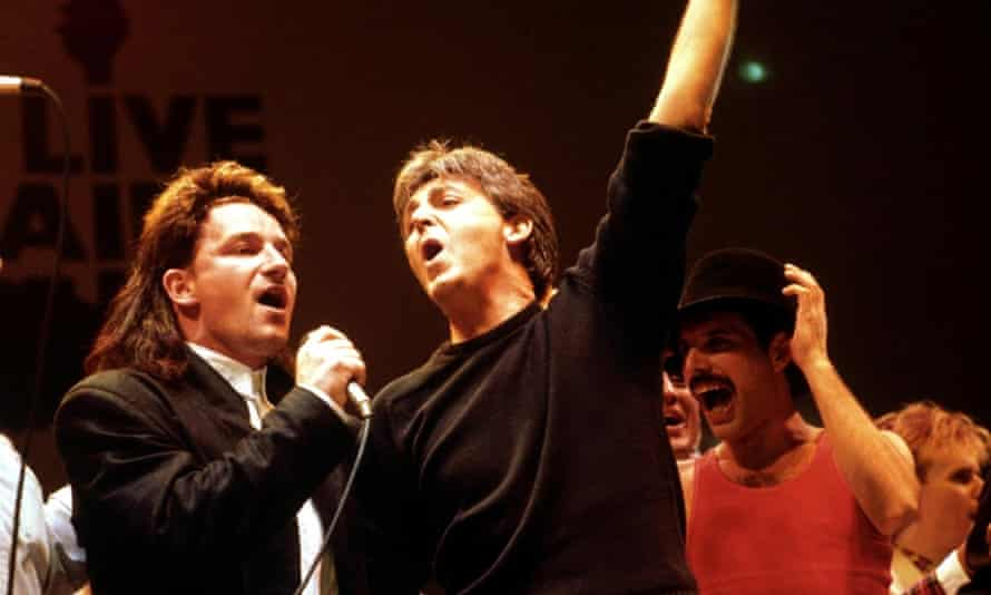 (L to R) Bono of U2, Paul McCartney, and Freddie Mercury perform in the finale of the Live Aid concert at Wembley stadium in 1985.