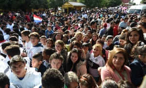 People wait to get a glimpse of Pope Francis during his visit to the Pediatric Hospital.