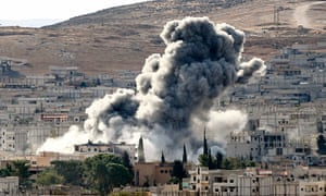 Smoke rises from an airstrike in Kobani, Syria, during fighting between Syrian Kurds and Isis