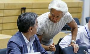 Greek finance minister Euclid Tsakalotos listens to IMF managing director Christine Lagarde