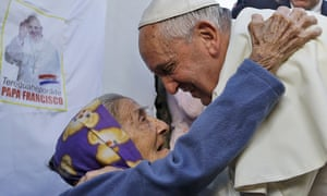 Pope Francis is greeted by a member of the faithful during his visit to the Banado Norte neighborhood. asuncion paraguay