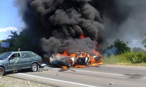 A burning police car in Mukacheve on Saturday.