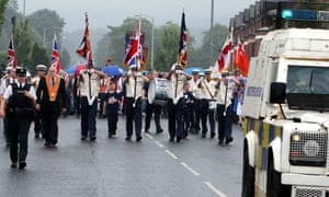 A file picture taken on July 12, 2014, shows police escorting an Orange Order parade past the nationalist Ardoyne area of North Belfast.