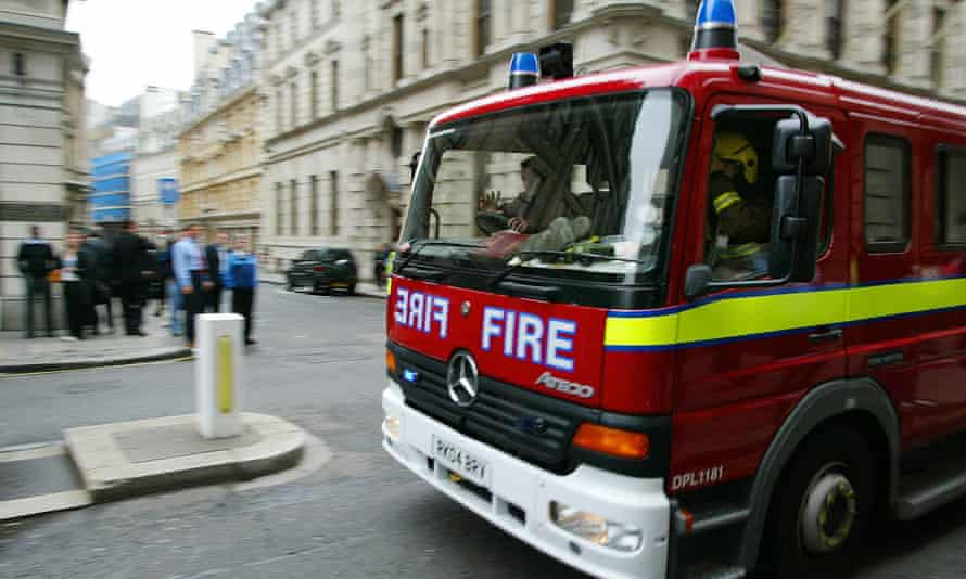 A fire engine heads to London's Aldgate East tube station