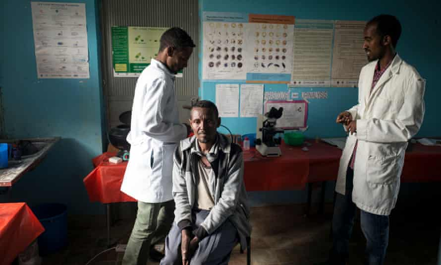 A man with suspected malaria waits to be tested by lab technicians in Derberk, Ethiopia in May 2015.