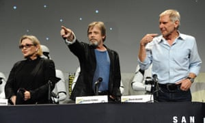 """Carrie Fisher, from left, Mark Hamill, and Harrison Ford attend Lucasfilm's """"Star Wars: The Force Awakens"""" panel"""