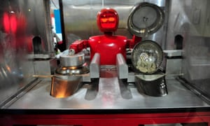 A robot that specialises in cooking, prepares jiaozi, or Chinese dumplings, at a Robot Restaurant in Harbin, Heilongjiang, China