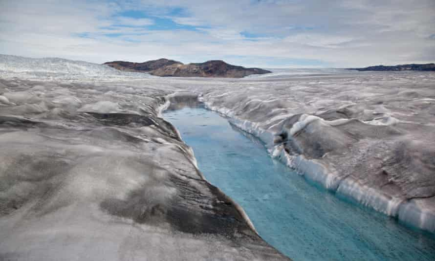 Dirty ice surrounds a meltwater stream near the margin of the Greenland ice sheet.