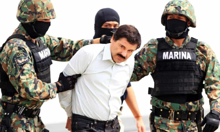 Mexico's most wanted . . . the Mexican military holding drug baron Joaquin Guzman in 2014. He has escaped from a maximum-security prison for the second time.