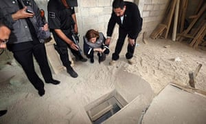 The Mexican general prosecutor inspects the tunnel that Joaquin 'Chapo' Guzman used to escape from high-security prison.