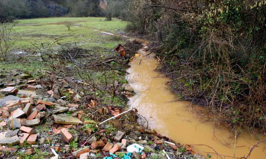 A discoloured stream running out of Brofiscin Quarry in south Wales. Toxic waste was dumped here in 1970s by contractors working for Monsanto.