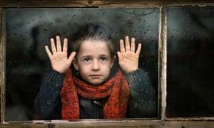Boy looking in through window