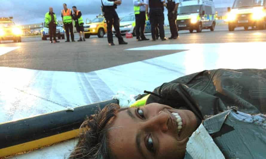 A climate change activist from Plane Stupid, on the north runway at Heathrow airport.