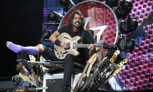 Foo Fighters' Dave Grohl performs with a cast at RFK Stadium in Washington. Grohl fell onstage in Sweden last month and fractured his foot.