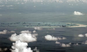 An aerial file photo taken though a glass window of a Philippine military plane shows the alleged on-going land reclamation by China on Mischief Reef in the Spratly Islands in the South China Sea, west of Palawan, Philippines, May 11, 2015