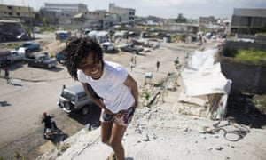 Linda Desammlouis, 22, stands on the rooftop of the earthquake-damaged building where a fluctuating population of homeless youth sleep in downtown Port-au-Prince.